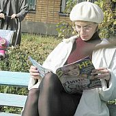 This blond was also busy reading a magazine to notice me spying on her hose and underskirt area.