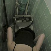 High angle shooting of unsuspicious angel on the piss-can by latrine voyeur camera.