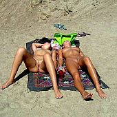 Large collection of nudist beach pictures and videos.