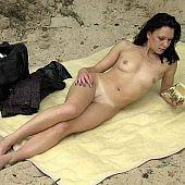 A playgirl sunbathing nude.