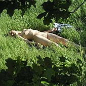 Female nudist taking a sun bath.
