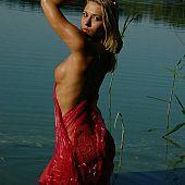 Blond beauty stripping lake.