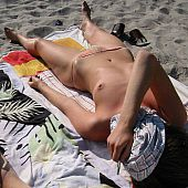In nature's garb  topless beach cuties receive caught on camera.