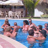 Nudist group pool pics from a intimate family naturist resort.