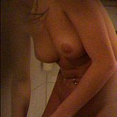 Spy pictures of a playgirl washing herself.
