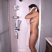 Breasty latin chick showering.