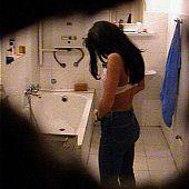 Hawt brunette hair preparing for a bath.